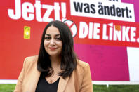 Ezgi Guyildar, the 35-year-old daughter of Kurdish refugees from Turkey, candidate of the German Left Party (Die Linke) for the upcoming parliament elections, smiles during an interview with the Associated Press in Berlin, Germany, Sunday, Sept. 19, 2021. Hundreds of immigrants are running in Germany's national election on Sunday, raising the possibility of making its next parliament more diverse than ever. While it still might not fully represent the country's overall diversity, where more than a quarter of the population has immigrant roots, it's a step toward a more accurate reflection of society. (AP Photo/Michael Sohn)