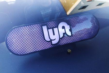 An illuminated sign appears in a Lyft ride-hailing car in Los Angeles