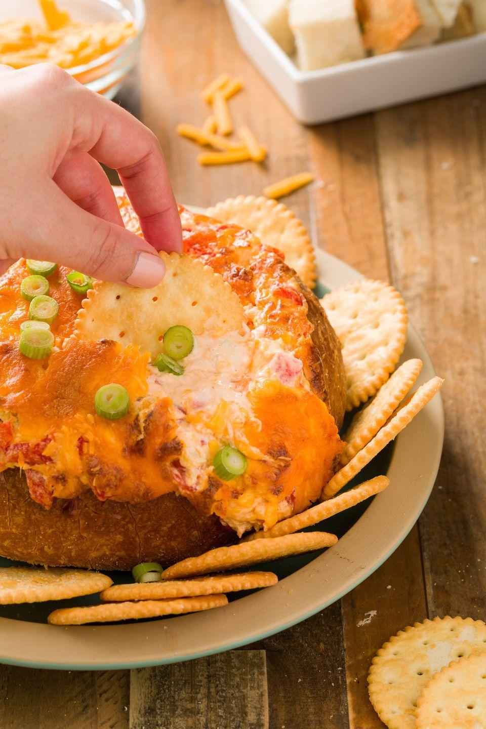 """<p>Fact: Loaded with Southern favorite pimiento cheese, this simple crowd-pleaser will always be the hit of a party spread.</p><p>Get the recipe from <a href=""""https://www.redbookmag.com/cooking/recipe-ideas/recipes/a44541/baked-pimiento-cheese-dip-in-a-bread-bowl-recipe/"""" rel=""""nofollow noopener"""" target=""""_blank"""" data-ylk=""""slk:Delish"""" class=""""link rapid-noclick-resp"""">Delish</a>.</p>"""