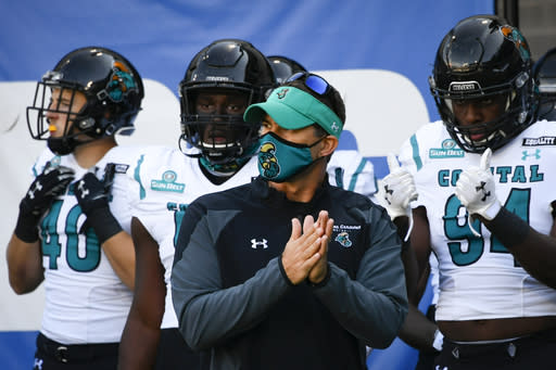 FILE - In this Oct. 31, 2020, file photo, Coastal Carolina coach Jamey Chadwell waits to lead his team onto the field for an NCAA football game against Georgia State in Atlanta. Chadwell is The Associated Press college football coach of the year after leading the Chanticleers to a surprising near-perfect season. Chadwell received 16 first-place votes and 88 points from the AP Top 25 panel to finish ahead of Indianas Tom Allen, who was second with 14 first-place votes and 66 points. (AP Photo/John Amis, File)