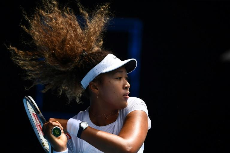 Japan's Naomi Osaka hits a return against France's Alize Cornet on her way to a straight-sets win