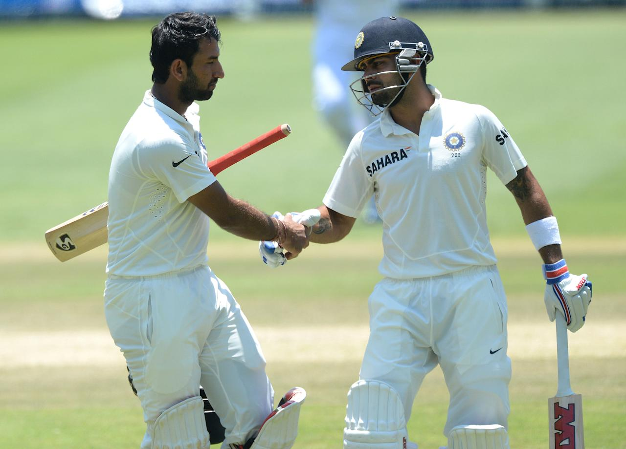 JOHANNESBURG, SOUTH AFRICA - DECEMBER 21:  Cheteshwar Pujara of India shakes hands with Virat Kohli (R) after being dimissed for 153 runs during day 4 of the 1st Test match between South Africa and India at Bidvest Wanderers Stadium on December 21, 2013 in Johannesburg, South Africa. (Photo by Duif du Toit/Gallo Images/Getty Images)