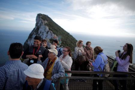 Spanish tourists are led by a guide on the top of the Rock in the British overseas territory of Gibraltar
