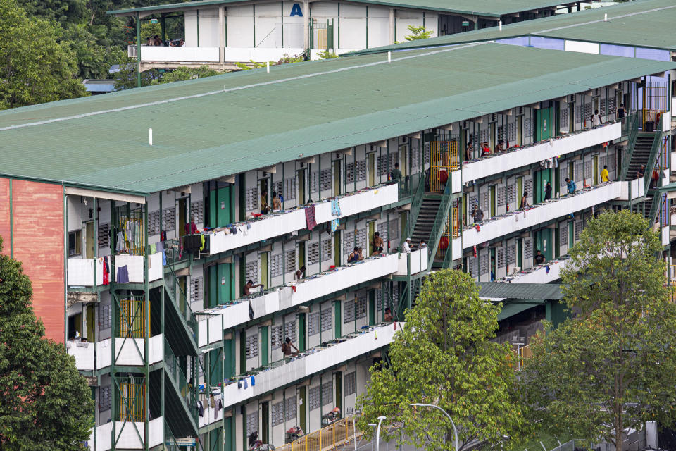 SINGAPORE, SINGAPORE - APRIL 18: Migrant workers can be seen in the Cochrane Lodge II, a purpose-built migrant workers dormitory that has been gazetted as an isolation area on April 18, 2020 in Singapore. (Photo by Ore Huiying/Getty Images)