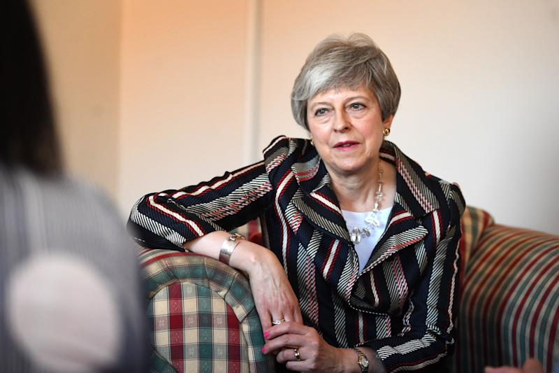 Prime Minister Theresa May talks with case workers and domestic violence survivors at Advance Charity offices in West London where she discussed support for victims of domestic violence.