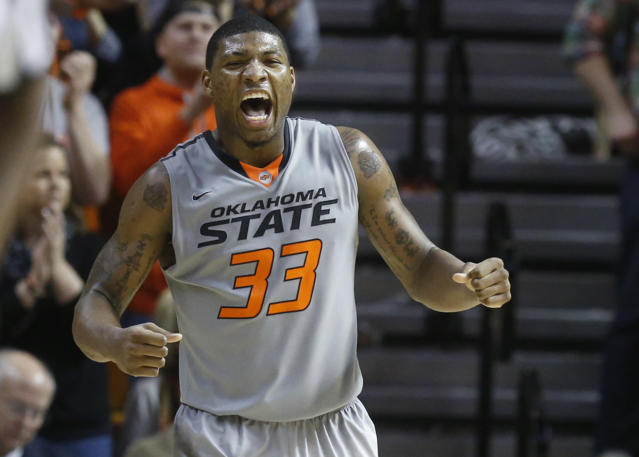Oklahoma State guard Marcus Smart (33) celebrates during the second half of an NCAA college basketball game against Kansas in Stillwater, Okla., Saturday, March 1, 2014. Oklahoma State won 72-65. (AP Photo/Sue Ogrocki)