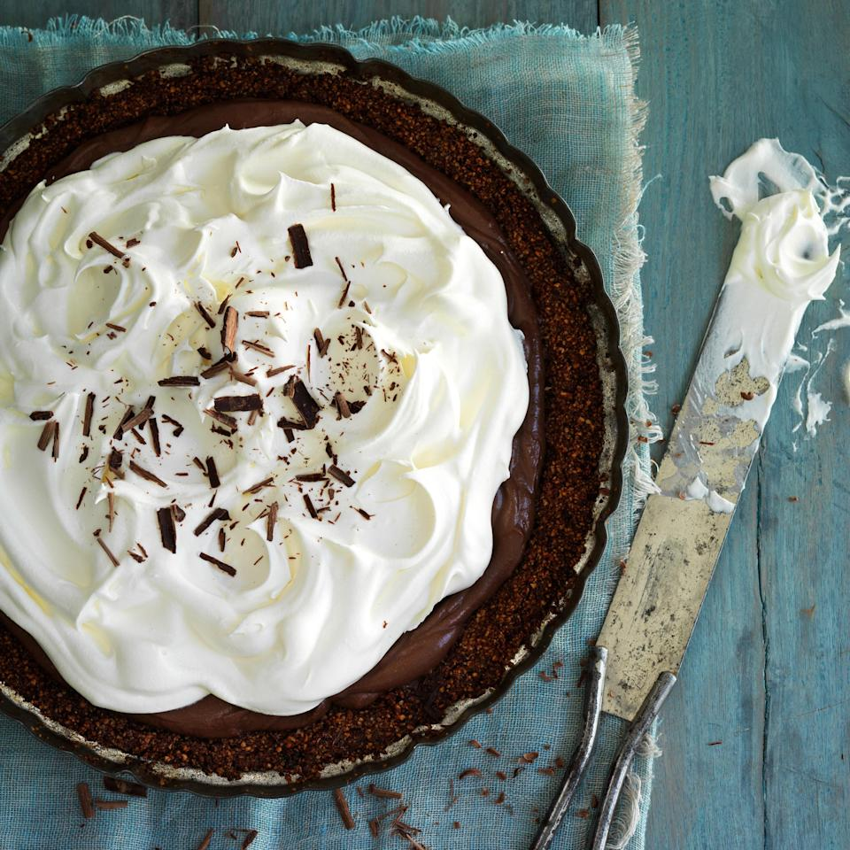 """The slightly crumbly hazelnut-cocoa crust in this pie is flourless—and it's a wonderful complement to the rich chocolate. Serve with coffee (or amaro). <a href=""""https://www.epicurious.com/recipes/food/views/chocolate-cream-pie-51258640?mbid=synd_yahoo_rss"""" rel=""""nofollow noopener"""" target=""""_blank"""" data-ylk=""""slk:See recipe."""" class=""""link rapid-noclick-resp"""">See recipe.</a>"""