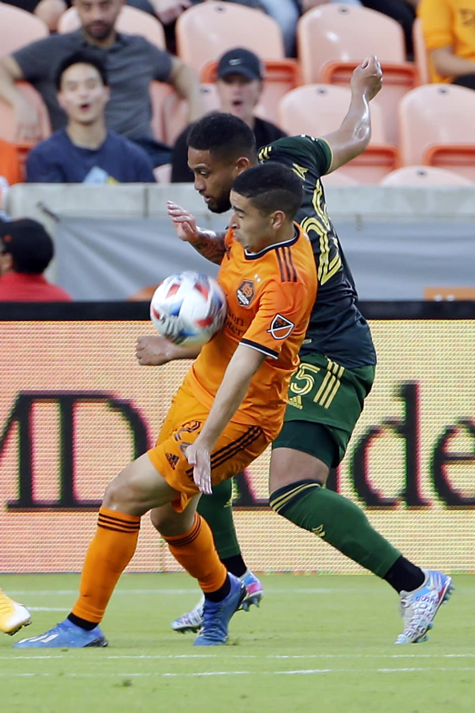 Houston Dynamo midfielder Matias Vera, front, brings down the ball in front of Portland Timbers defender Bill Tuiloma, back during the first half of an MLS soccer match Wednesday, June 23, 2021, in Houston. (AP Photo/Michael Wyke)
