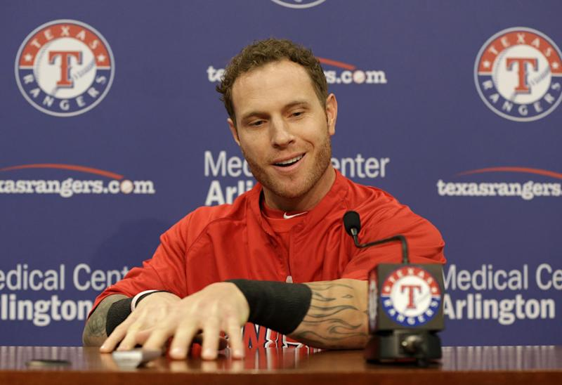 Los Angeles Angels' Josh Hamilton responds to a question from a reporter during a news conference before a baseball game against the Texas Rangers Friday, April 5, 2013, in Arlington, Texas. (AP Photo/Tony Gutierrez)