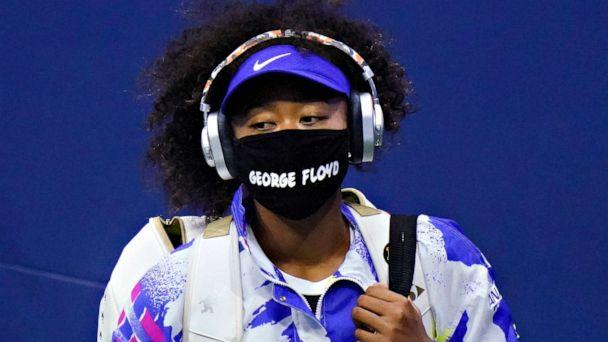 PHOTO: Naomi Osaka wears a mask featuring George Floyd's name as she arrives on court to face Shelby Rogers during the quarterfinal round of the US Open tennis Championships, Sept. 8, 2020, in Queens, New York. (Frank Franklin Ii/AP)