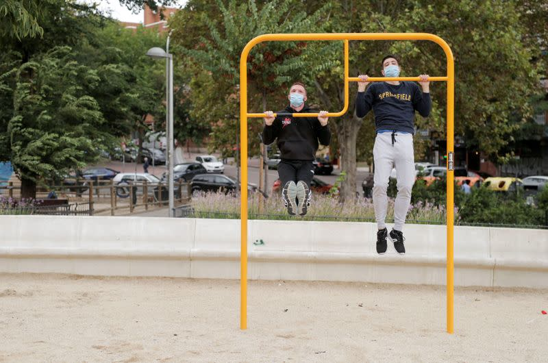 People, wearing protective face masks exercise at Carabanchel neighbourhood in Madrid