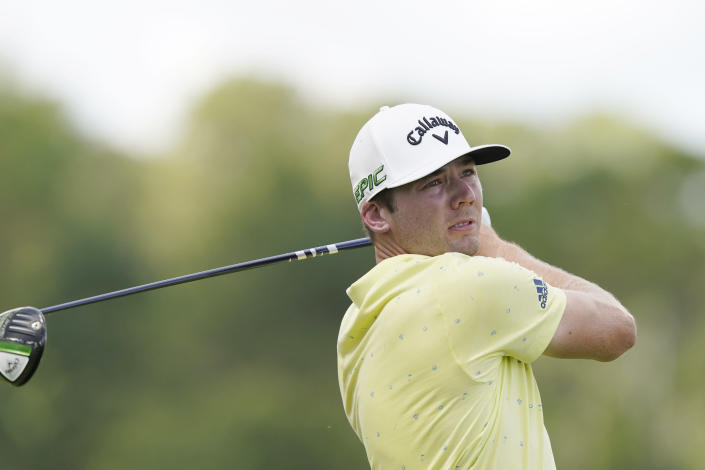 Sam Burns watches his drive from the second tee during the final round of the Sanderson Farms Championship golf tournament in Jackson, Miss., Sunday, Oct. 3, 2021. (AP Photo/Rogelio V. Solis)