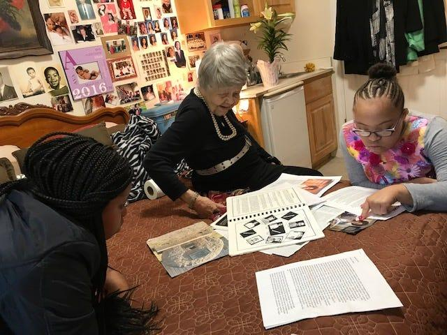 """Harriett Barfield Black, Berry's 101-year-old great aunt, showed the Barfield family tree in Atlanta in April to her great nieces Amaya Berry (left) and India Brodie (right). In 1941, Barfield Black was the first graduate of Fort Valley State University, a historically black college in Georgia. She is the oldest surviving alumni and was honored recently on campus where Fort Valley Mayor Barbara Williams gave her a key to the city. """"It's great to give those folks their flowers while they live,'' Williams said. Barfield Black still hasn't gotten over the surprise celebration. """"I just like to have died,'' she said."""