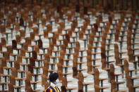 A Swiss guard walks past empty seats on the occasion of the weekly general audience at the Vatican, Wednesday, Oct. 21, 2020. (AP Photo/Gregorio Borgia)