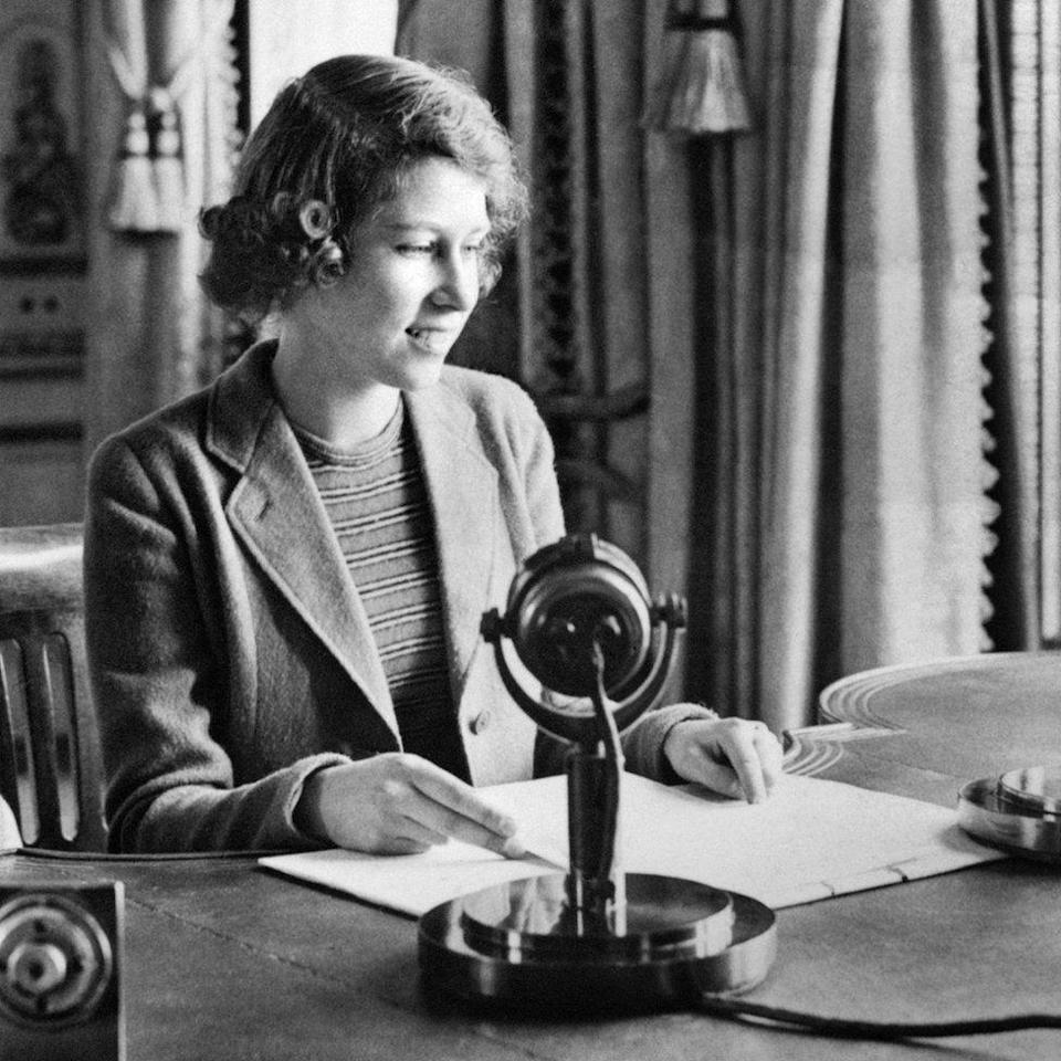 <p>A 14-year-old Elizabeth appears on the radio in a programme called Children's Hour (PA Archive) </p>