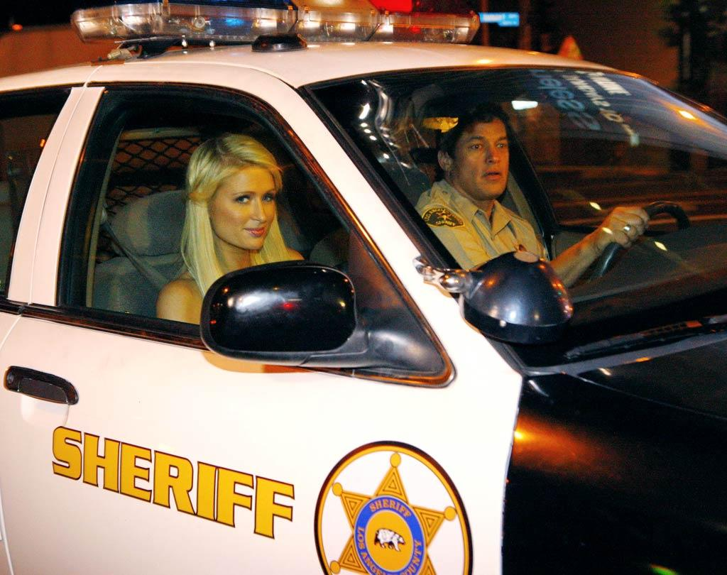 "Paris Hilton was back in familiar territory Tuesday when she found herself sitting in a police car. This time though, it was all for a good cause, as the actress was filming a Public Service Announcement for the Los Angeles Sheriff's Department. The PSA is part of the court ordered community service she has to complete as a result of having been charged with cocaine possession in Las Vegas last August. Karl Larsen/<a href=""http://www.infdaily.com"" target=""new"">INFDaily.com</a> - January 18, 2011"