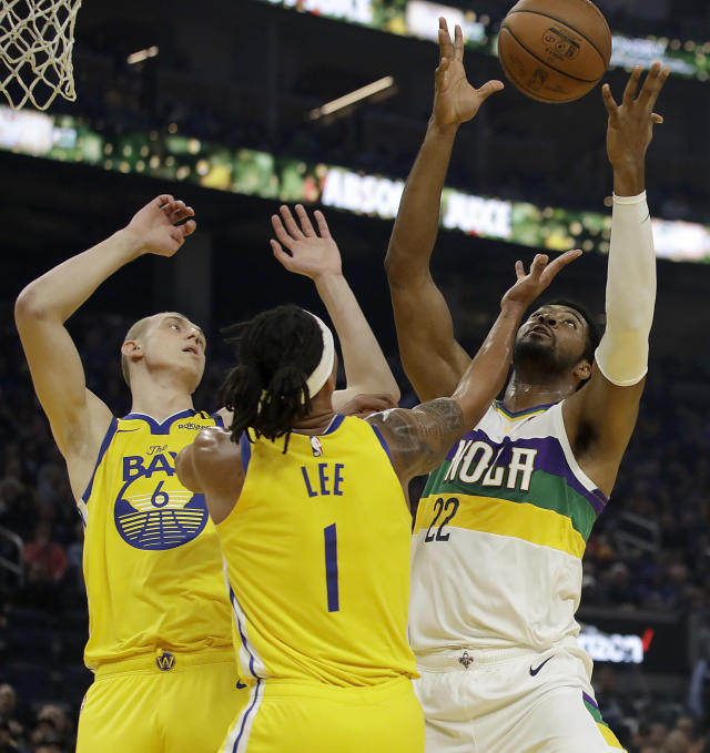 New Orleans Pelicans' Derrick Favors, right, rebounds the ball over Golden State Warriors' Alen Smailagic, left, and Damion Lee (1) during the first half of an NBA basketball game Sunday, Feb. 23, 2020, in San Francisco. (AP Photo/Ben Margot)