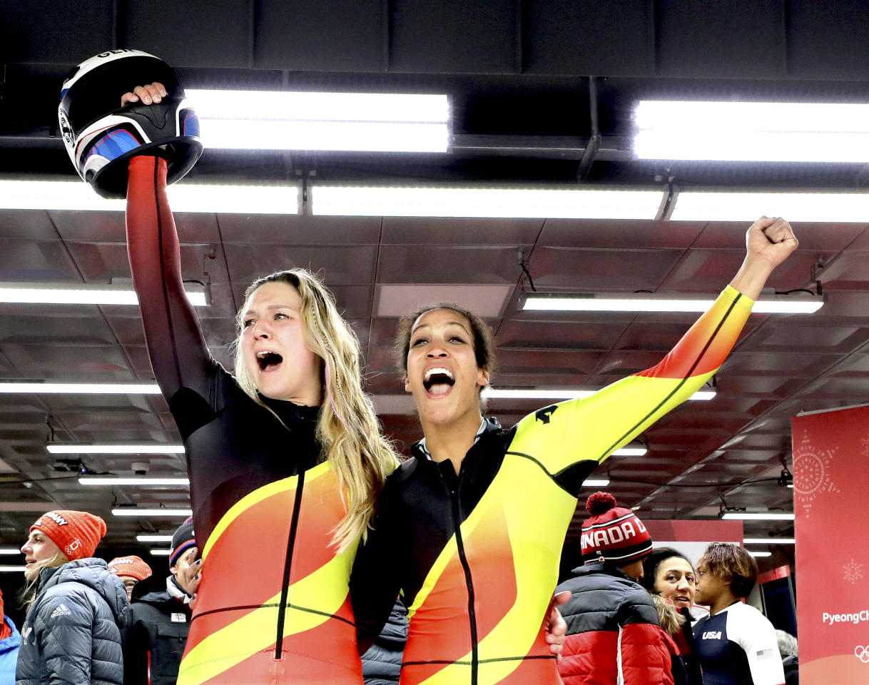 <p>Germany's Mariama Jamanka and Lisa Buckwitz celebrate after their gold medal winning run during the Women's Bobsled Final at the 2018 Winter Olympics in PyeongChang, South Korea, Wednesday, Feb. 21, 2018.<br />(AP Photo/Wong Maye-E) </p>