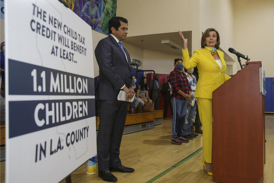LOS ANGELES, CA - July 15: U.S. Representative Jimmy Gomez, left, watches as Speaker of the House Nancy Pelosi speaks about the expansion of the child tax credit during a press conference held at Barrio Action Youth and Family Center on Thursday July 15, 2021 in Los ngeles, California.  (Irfan Khan / Los Angeles Times via Getty Images)