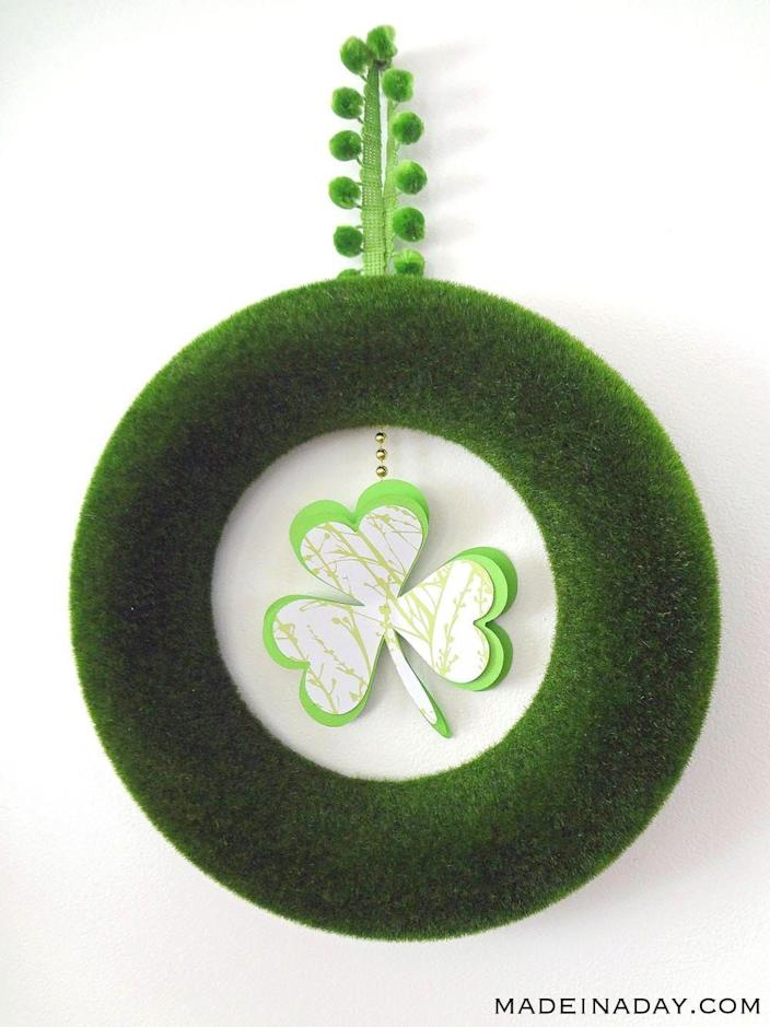 """<p>Just because it's minimalistic doesn't mean it doesn't have maximum wit and style. This wreath is especially cute with its fun pom-pom trim hanger.</p><p><strong>Get the tutorial at <a href=""""https://madeinaday.com/st-patricks-day-shamrock-wreath/"""" rel=""""nofollow noopener"""" target=""""_blank"""" data-ylk=""""slk:Made in a Day"""" class=""""link rapid-noclick-resp"""">Made in a Day</a>.</strong></p><p><a class=""""link rapid-noclick-resp"""" href=""""https://go.redirectingat.com?id=74968X1596630&url=https%3A%2F%2Fwww.walmart.com%2Fsearch%2F%3Fquery%3Dartificial%2Bmoss%2Bwreath&sref=https%3A%2F%2Fwww.thepioneerwoman.com%2Fhome-lifestyle%2Fcrafts-diy%2Fg34931626%2Fst-patricks-day-decorations%2F"""" rel=""""nofollow noopener"""" target=""""_blank"""" data-ylk=""""slk:SHOP ARTIFICIAL MOSS WREATHS"""">SHOP ARTIFICIAL MOSS WREATHS</a><br></p>"""