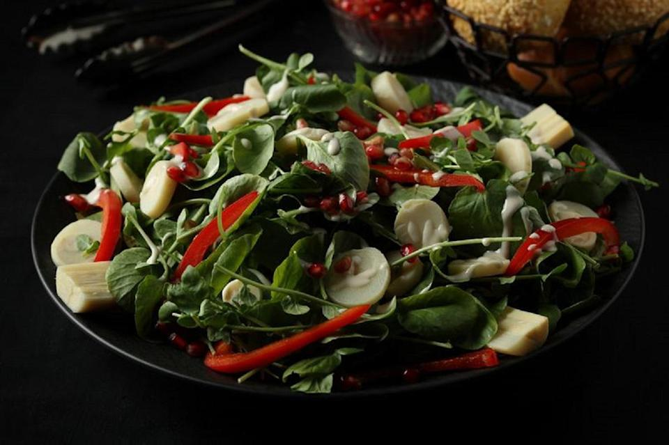 """<p>Watercress is a delicate green, which makes it ideal for serving as an appetizer or side dish to a <a href=""""https://www.thedailymeal.com/cook/how-grill-perfect-steak-gallery?referrer=yahoo&category=beauty_food&include_utm=1&utm_medium=referral&utm_source=yahoo&utm_campaign=feed"""" rel=""""nofollow noopener"""" target=""""_blank"""" data-ylk=""""slk:hearty cut of steak"""" class=""""link rapid-noclick-resp"""">hearty cut of steak</a> or other filling meal. Brighten the dish up with tahini dressing, bell pepper and pomegranate seeds. </p> <p><a href=""""https://www.thedailymeal.com/recipe/watercress-and-hearts-of-palm-salad-with-tahini-dressing?referrer=yahoo&category=beauty_food&include_utm=1&utm_medium=referral&utm_source=yahoo&utm_campaign=feed"""" rel=""""nofollow noopener"""" target=""""_blank"""" data-ylk=""""slk:For the Watercress and Hearts of Palm Salad With Tahini Dressing recipe, click here."""" class=""""link rapid-noclick-resp"""">For the Watercress and Hearts of Palm Salad With Tahini Dressing recipe, click here.</a></p>"""