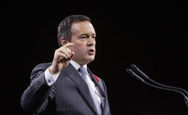 'We will not permit our health-care system to be overwhelmed,' Alberta Premier Jason Kenney said Tuesday, as he announced new public health measures to combat COVID-19. (Jason Franson/The Canadian Press - image credit)