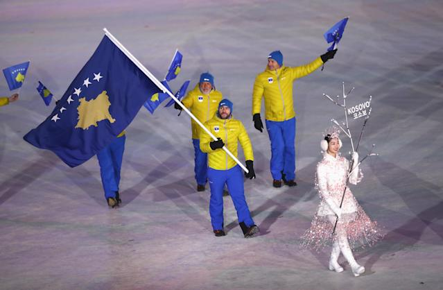 <p>Flag bearer Albin Tahiri of Kosovo leads the team during the Opening Ceremony of the PyeongChang 2018 Winter Olympic Games at PyeongChang Olympic Stadium on February 9, 2018 in Pyeongchang-gun, South Korea. (Photo by Ronald Martinez/Getty Images) </p>
