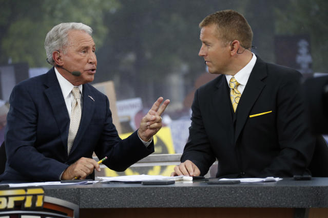 Lee Corso wants Kirk Herbstreit to know that ESPN has now used two Imagine Dragons songs in its promos. (AP Photo/Rogelio V. Solis)
