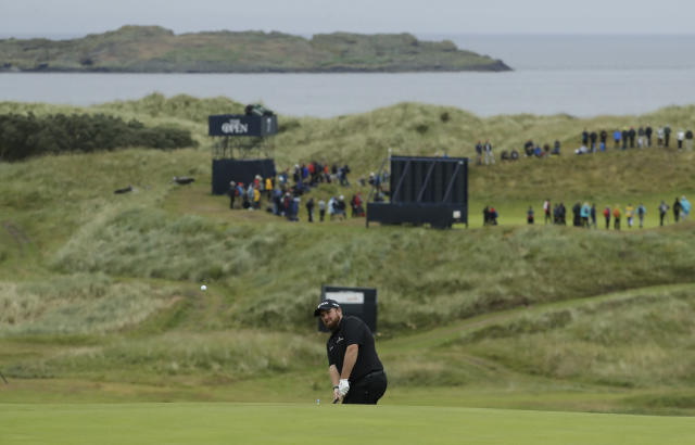 Ireland's Shane Lowry chips onto the 16th green during the second round of the British Open Golf Championships at Royal Portrush in Northern Ireland, Friday, July 19, 2019.(AP Photo/Matt Dunham)