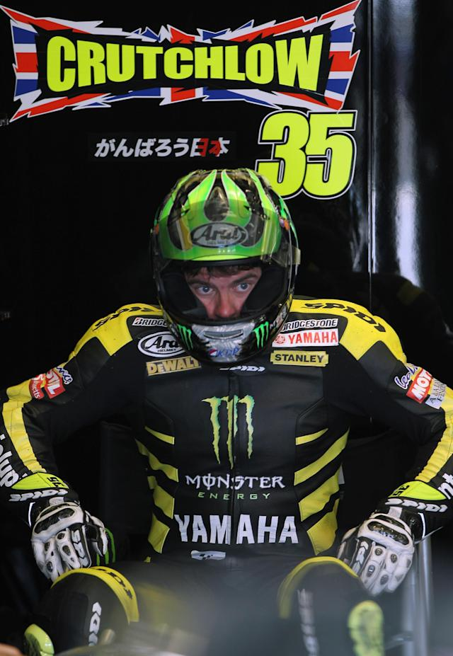INDIANAPOLIS, IN - AUGUST 27: Cal Crutchlow #35 of Great Britain watches from the pit garage during Moto GP qualifying at Indianapolis Motorspeedway on August 27, 2011 in Indianapolis, Indiana. (Photo by Jamie Squire/Getty Images)