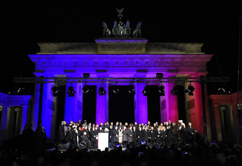 Political and religious leaders attend a Muslim community rally to condemn the Paris jihadist attacks and promote tolerance, on January 13, 2015 in front of the Brandenburg Gate in Berlin