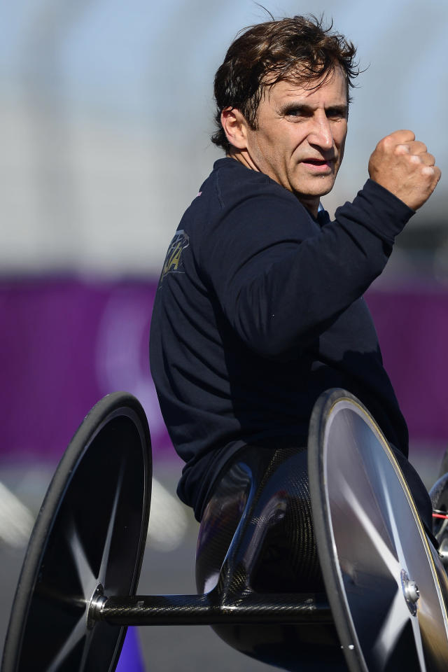 Italy's Alessandro Zanardi celebrates after winning the gold medal in the men's individual H4 time trial cycling final during the London 2012 Paralympic Games at Brands Hatch circuit, in Kent, southern England on September 5, 2012. AFP PHOTO / LEON NEALLEON NEAL/AFP/GettyImages