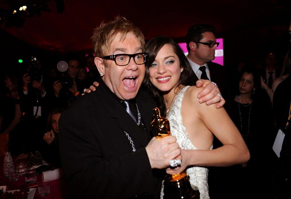 "Elton John and <a href=""http://movies.yahoo.com/movie/contributor/1800277301"">Marion Cotillard</a> attend the 16th Annual Elton John AIDS Foundation Oscar Party at the Pacific Design Center in West Hollywood - 02/24/2008"