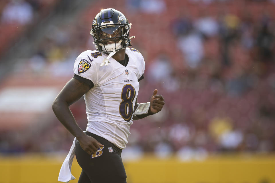 LANDOVER, MD - AUGUST 28: Lamar Jackson #8 of the Baltimore Ravens looks on against the Washington Football Team during the first half of the preseason game at FedExField on August 28, 2021 in Landover, Maryland. (Photo by Scott Taetsch/Getty Images)