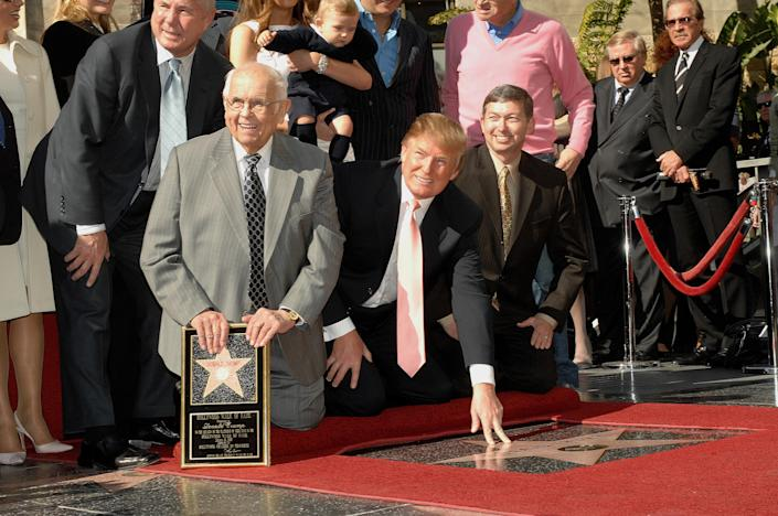 Johnny Grant (L) (honorary Mayor of Hollywood), and Leron Gubler (R) (President/CEO, Hollywood Chamber of Commerce) at the star ceremony Honoring Donald Trump (C) on the Hollywood Walk of Fame. (Photo by Frank Trapper/Corbis via Getty Images)