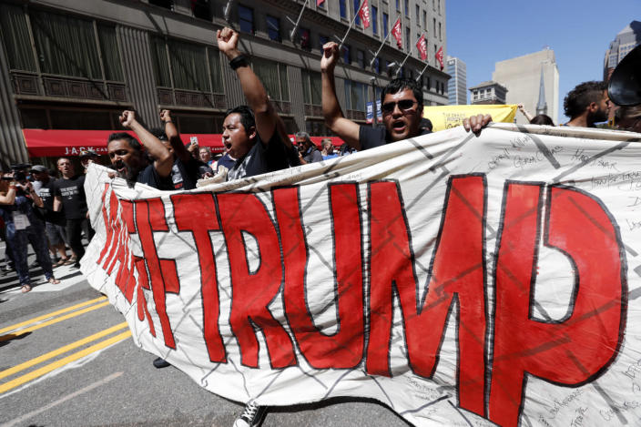 <p>Immigrant rights activists hold up a fabric wall protesting against Republican presidential candidate Donald Trump, Wednesday, July 20, 2016, in Cleveland, during the third day of the Republican convention. (Photo: Alex Brandon/AP)</p>