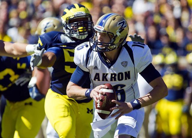 Michigan defensive tackle Jibreel Black (55) pressures Akron quarterback Kyle Pohl (16) in the first quarter of an NCAA college football game, Saturday, Sept. 14, 2013, in Ann Arbor, Mich. (AP Photo/Tony Ding)