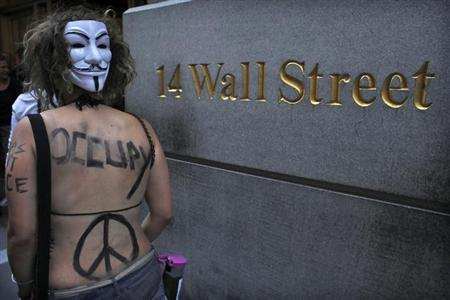 An Occupy Wall Street activist takes part in a march in downtown Manhattan in New York