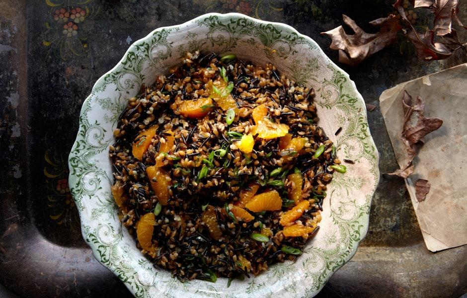 "Both the wild rice and the farro can be cooked a day in advance; let them cool separately on baking sheets, then cover and chill. Bring to room temperature before dressing. <a href=""https://www.bonappetit.com/recipe/wild-rice-farro-and-tangerine-salad?mbid=synd_yahoo_rss"" rel=""nofollow noopener"" target=""_blank"" data-ylk=""slk:See recipe."" class=""link rapid-noclick-resp"">See recipe.</a>"