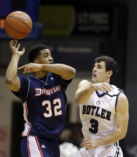 Butler guard Alex Barlow, right, knocks the ball away from Duquesne guard Sean Johnson during the first half of an NCAA college basketball game in Indianapolis, Tuesday, Feb. 19, 2013. (AP Photo/Michael Conroy)