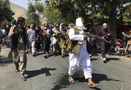 Taliban soldiers walk towards Afghans shouting slogans, during an anti-Pakistan demonstration, near the Pakistan embassy in Kabul, Afghanistan, Tuesday, Sept. 7, 2021. (AP Photo/Wali Sabawoon)