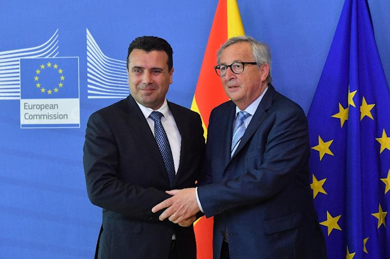 North Macedonia's Prime Minister Zoran Zaev (L) is welcomed by European Commission President Jean-Claude Juncker at the European Commission in Brussels on June 4, 2019