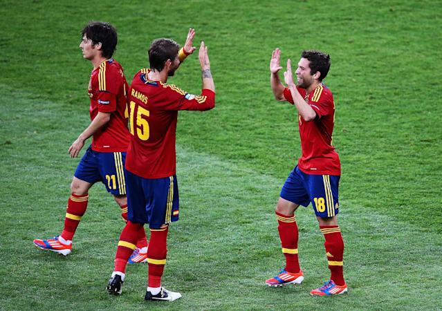 KIEV, UKRAINE - JULY 01: Jordi Alba (R) of Spain celebrates with team-mates Sergio Ramos (C) and David Silva after scoring his team's second goal during the UEFA EURO 2012 final match between Spain and Italy at the Olympic Stadium on July 1, 2012 in Kiev, Ukraine. (Photo by Martin Rose/Getty Images)
