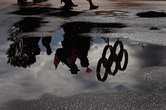 The Olympic Rings are reflected in a puddle in the Olympic Park on Day 2 of the London 2012 Olympic Games on July 29, 2012 in London, England. (Photo by Jeff J Mitchell/Getty Images)