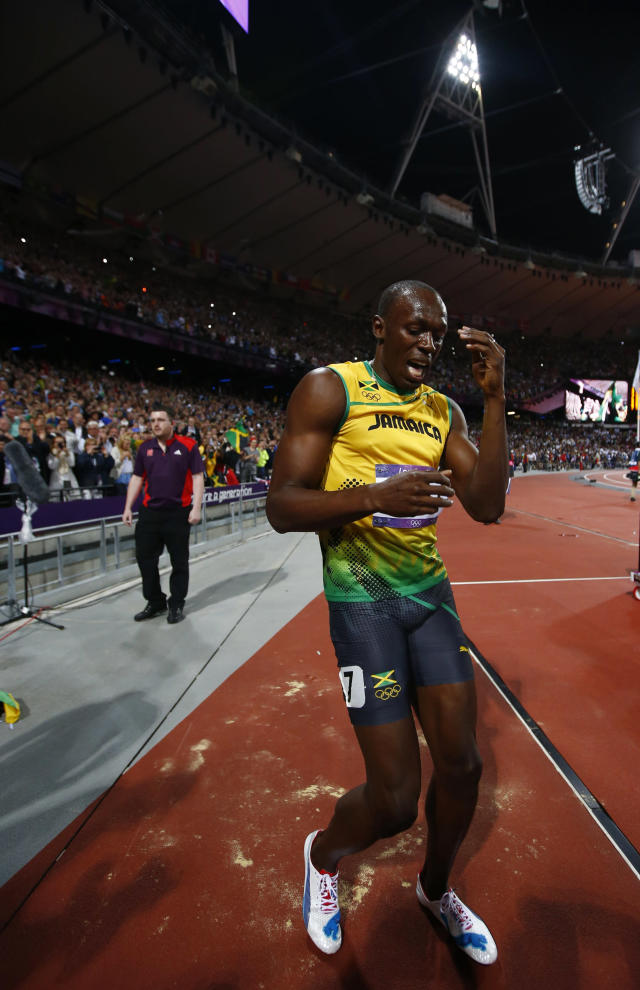Jamaica's Usain Bolt celebrates after winning the men's 100m final during the London 2012 Olympic Games at the Olympic Stadium August 5, 2012. REUTERS/Kai Pfaffenbach (BRITAIN - Tags: OLYMPICS SPORT ATHLETICS)