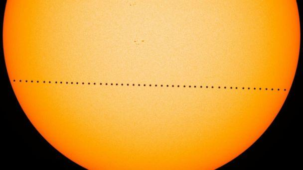 PHOTO: A time-lapse image provided by NASA, shows the tiny dot of Mercury sliding across the sun the during the transit of Mercury on May 9, 2016. On Monday, Nov. 11, 2019, the planet Mercury will make another transit across the sun. (NASA)