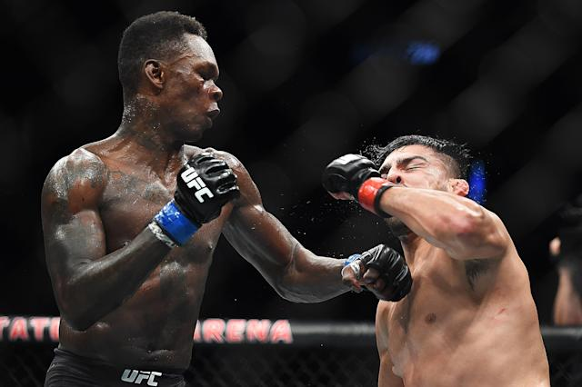 Both Israel Adesanya (L) and champion Robert Whittaker (not pictured) have shown they can metaphorically dig deep and win fights after being hurt and exhausted. (Getty Images)