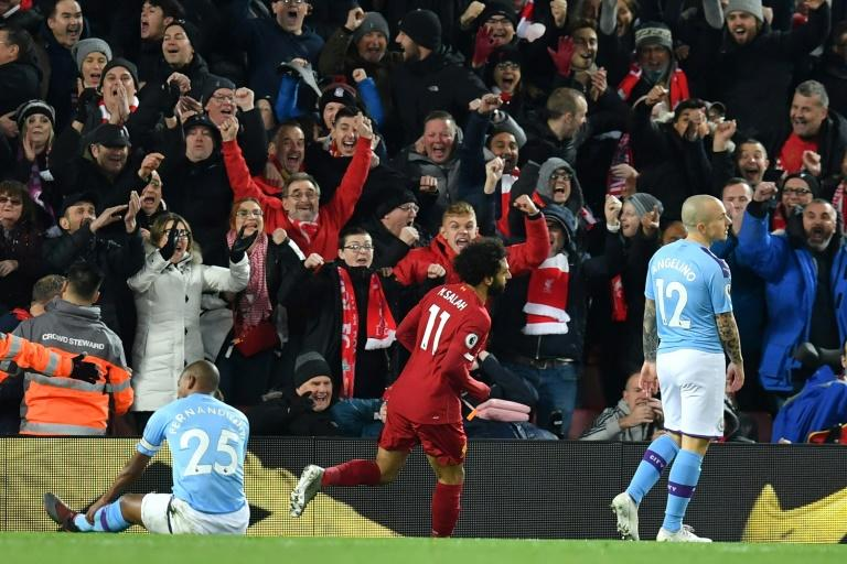 Mohamed Salah (C) celebrates scoring for leaders Liverpool in a Premier League victory over Manchester City last Sunday