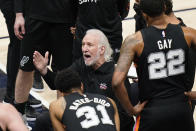 San Antonio Spurs head coach Gregg Popovich huddles with his team in the first half during an NBA basketball game against the Utah Jazz Monday, May 3, 2021, in Salt Lake City. (AP Photo/Rick Bowmer)