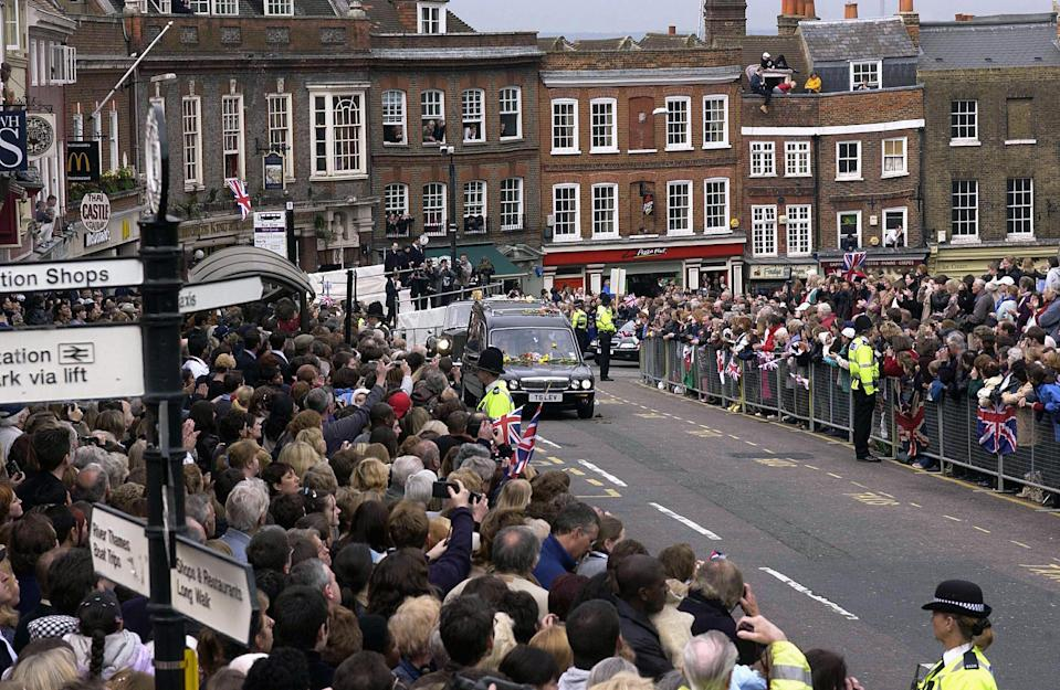 The Queen Mother's hearse being driven through WindsorDavid Hartley/Shutterstock